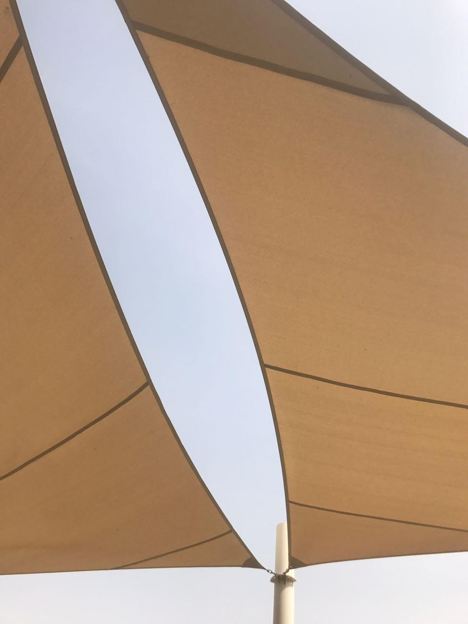 triangle sail shades installation in abu dhabi